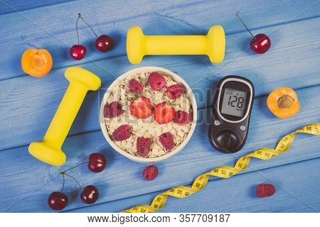 Glucose Meter With Result Of Sugar Level, Oat Flakes With Fruits, Tape Measure And Dumbbells For Fit