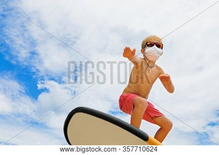 Young Funny Surfer Wearing Sunglasses, Protective Face Mask Ride On Surfboard. Summer Beach Tours, C