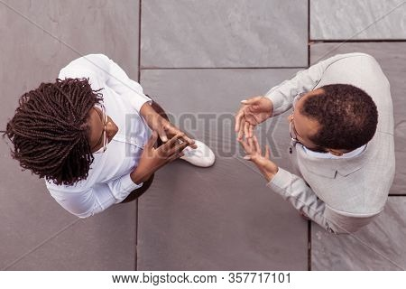 Top View Of Two Business People Talking. African American Man And Woman Wearing Formal Wear Discussi