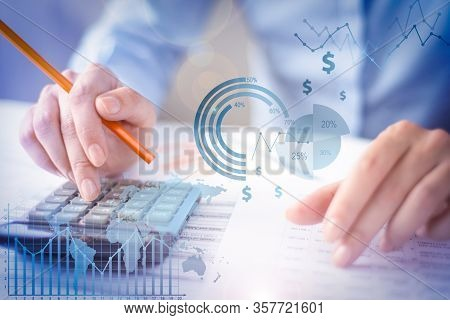 Manager Calculating Data With Financial Analysis Graphs During Paperwork. Banking Specialist Examini