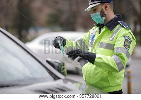 Romanian Road Police Officer Pulls Over A Car To Check For The Driver's Identity Papers.