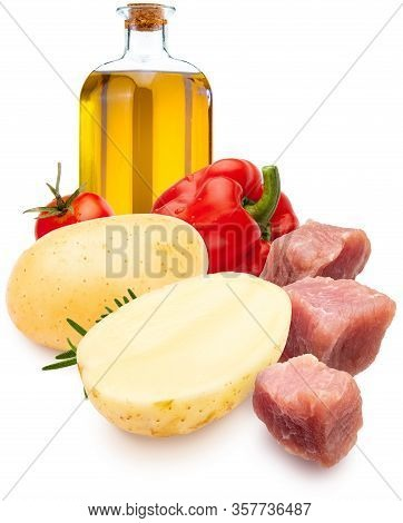 Ingredients For Stew. Dices Of Meat, Potatoes, Red Pepper, Olive Oil And Rosemary. Isolated On White