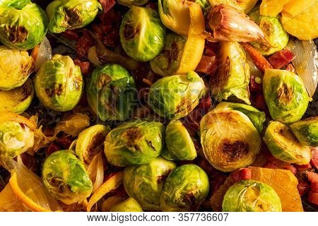 Cooked Brussels Sprouts (cabbages) With Ham, Garlic, Oil And Orange. Rustic And Homemade Looking Rec
