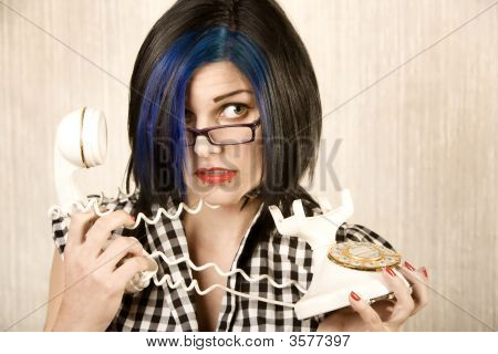 Pretty Young Woman Wrapped In A Phone Cord
