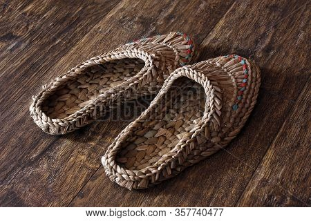 Wicker Home Low Slippers, Bast Shoes Or Lapti Woven From Wood Bast. A Modern Version Of Old Traditio