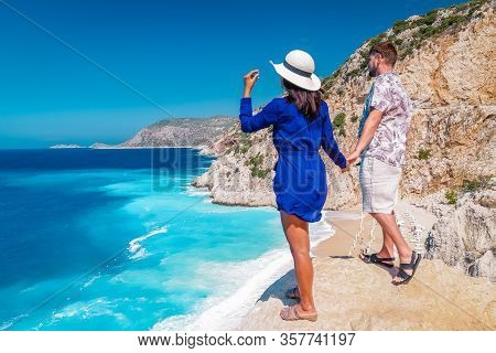Couple On Vacation Turkey , Kaputas Beach Kas Turkey, White Orange Beach From Clifs By The Ocean Of