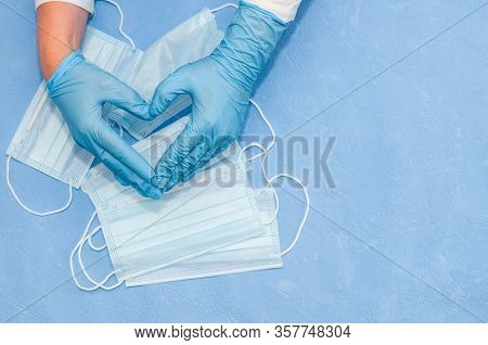 Protective Medical White Face Mask On A Blue Background. View From Above. Virus Prevention Space For