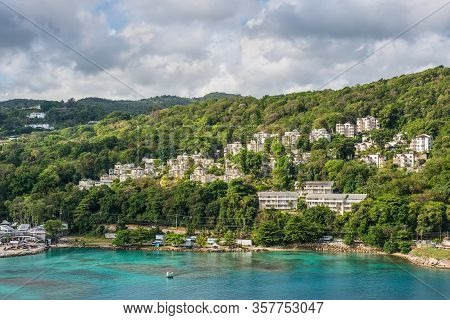 Ocho Rios, Jamaica - April 22, 2019: Coastline View With Lots Of Living Houses On The Hill, In The T