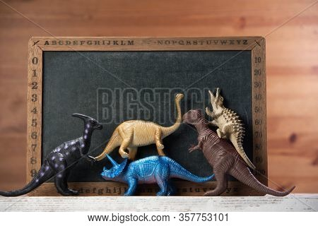 toy dinosaur on the mini blackboard