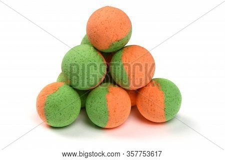 Close Up View Of Green Orange Boilies, Fishing Baits For Carp Isolated On White Background. High Res