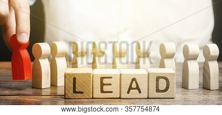 Man Puts A Leader At Head Of Line Of People. Project Leadership. Appointment To A Responsible Post,
