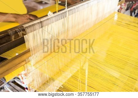 Close-up View Of Old Traditional Loom, Working Thread From Weaving Machine