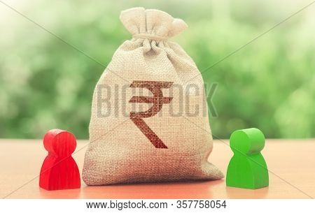 Indian Rupee Money Bag And A Deal Between Two Persons. Business Lending, Leasing. Tender Competition