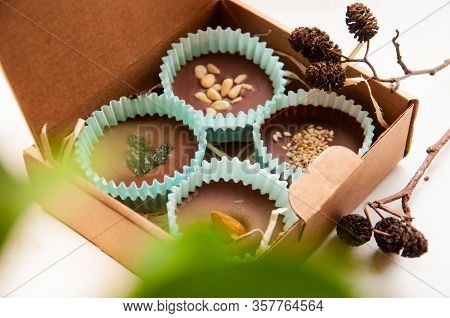 Candy Chocolate Dessert Sweet Food. Assorted Chocolate Pralines On Brown Background.