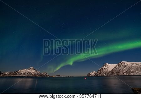 The Polar Arctic Northern Lights Aurora Borealis Sky Star In Norway Mountains, Long Shutter Speed.