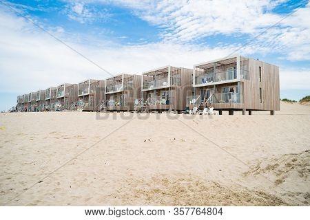 Hoek Van Holland, Netherlands - May 21, 2018: Several Wooden Beach Holiday Apartments Along The Dutc
