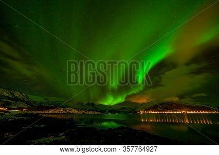 Aurora Borealis On The Lofoten Islands, Norway. Green Northern Lights Above Mountains. Night Sky Wit