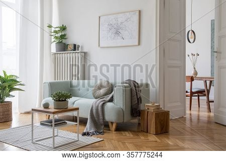 Stylish Scandinavian Living Room And Dining Room. Mint Sofa, Wooden Table, Chairs, Design Coffee Tab