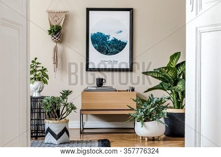 Modern Scandinavian Living Room Interior With Black Mock Up Poster Frame, Design Commode, A Lot Of P