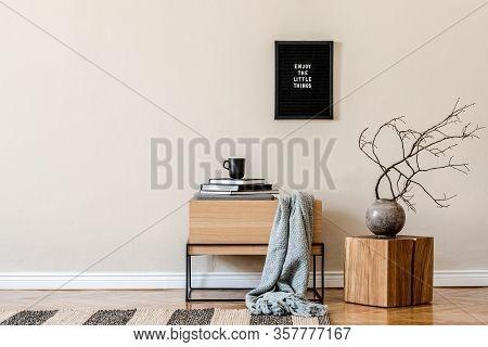 Modern Scandinavian Living Room Interior With Black Mock Up Poster Frame, Design Commode And Elegant