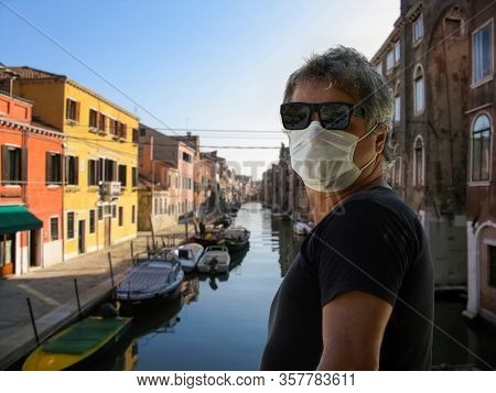 Male Wearing Face Mask In A Empty Venice Street After The Coronavirus Italy Lockdown, Deserted Venic