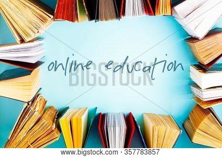 Flat Lay Frame Of Old Books On Blue Background, Online Ducation Concept