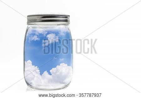 Beautiful Blue Sky Or Fresh Air In Fat Shape Glass Bottle With Aluminum Lid. Isolated On White Backg