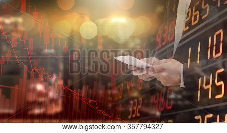 Businessman Using Tablet Analyzing Data. He Paranoid World Of Economy Finance Stock Graph And Market