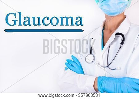 Doctor In Medical Clothes On A Light Background With The Text Glaucoma. Medical Concept.