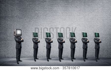 Businessmen In Suits With Monitors Instead Of Their Heads Keeping Arms Crossed While Standing In A R