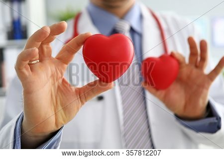Gp Showing Two Red Hearts In Camera Close-up. Cardio Therapeutist Student Education Cpr Life Save Gp