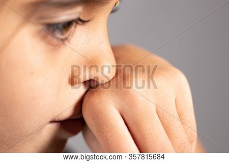 Extreme Close Up Of Child Touch's Her Nose - Concept Showing To Prevent And Avoid Touching Your Nose