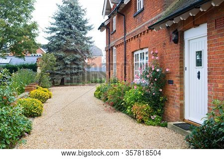 English Country House And Garden In Autumn With A Gravel Driveway. The House Is Victorian Period, Wi