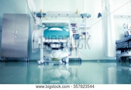 Defocused Medical Background With Emergency Room Equipment In The Hospital.