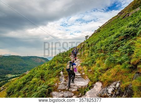 Ben Nevis / Uk - August 24 2019: People Hike On The Mountain Path, The Most Popular Route Up Ben Nev