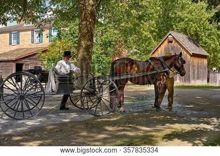 Top Canadian Village, Morrisburg, Ontario, Canada - October 17, 2019. Coachman With A Horse And A Ho