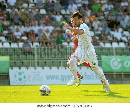 KAPOSVAR, HUNGARY - AUGUST 4: Bojan Vrucina (in white) in action at a Hungarian National Championship soccer game Kaposvar (white) vs Debrecen (red) August 4, 2012 in Kaposvar, Hungary.