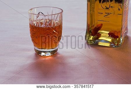 Bakhmut, Ukraine, March, 2020. Vodka With Pepper In A Branded Bottle And A Glass Of Vodka.
