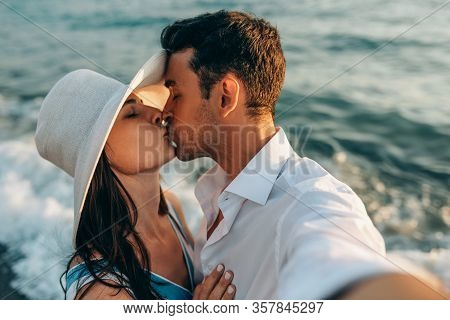 Closeup Self-portrait Of Couple In Love Kissing Each Other. Honeymoon Of Young Happy Couple. Family