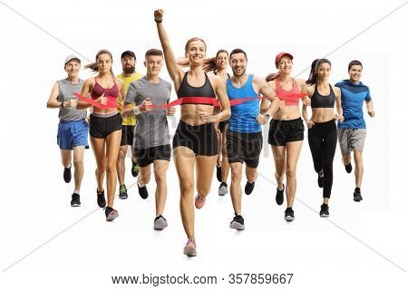 Full length portrait shot of people running a marathon race and a young woman finishing first isolated on white background