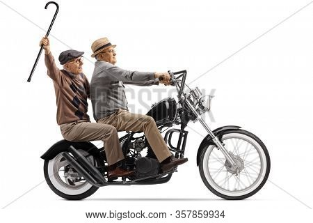 Full length profile shot of two senior men riding on a custom chopper motorbike isolated on white background