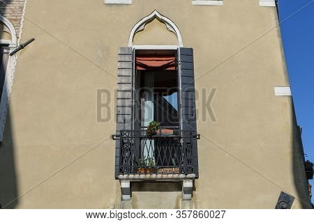 A Close Up Of A Window In Venice Italy