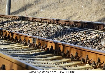 Rails, Sleepers And Gravel Railroad. Railroad Track And Gravel Mound. City ​​transport Artery