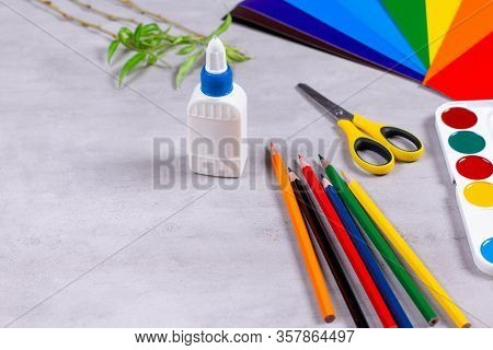 Sheets Of Paper, Glue And Scissors On A Table, Copy Space