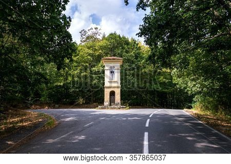 Solitary Chapel On Crossroad In Middle Of Beautiful Woods, Road Traffic, Loneliness Or Coronavirus Q