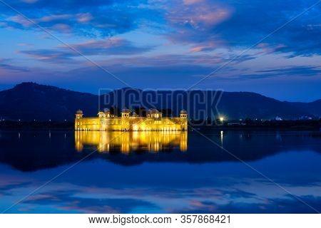 Rajasthan famous tourist landmark - Jal Mahal Water Palace on Man Sagar Lake in the evening in twilight. Jaipur, Rajasthan, India