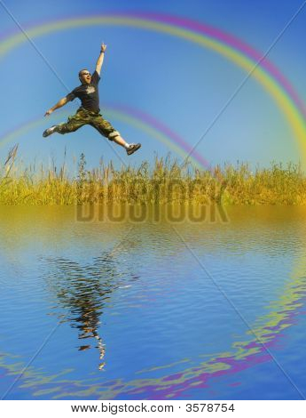 Man Jumping On A Meadow