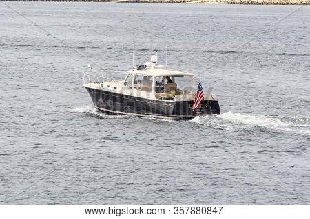 New Bedford, Massachusetts, USA - June 7, 2019: Yacht Ellie K, hailing port Westport, MA, easing across New Bedford outer harbor