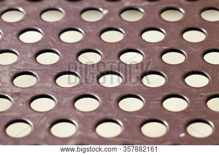 Metal Surface With Round Holes For Ventilation Or Cheaper Construction, Close Up