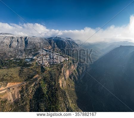Aerial View Of Delphi, Greece At Sunrise, The Gulf Of Corinth, Morning Fog Over Mountains, Hoarfrost